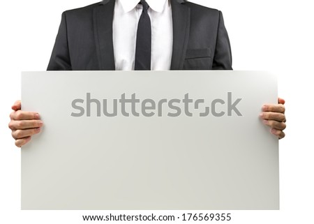 Businessman holding a blank white rectangular sign with copyspace for your text or advertisement, torso view closeup on his hands and the sign, isolated on white. - stock photo