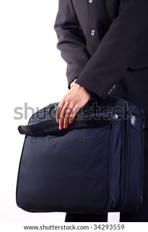 Businessman holding a briefcase - stock photo