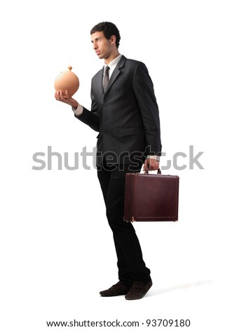 Businessman holding a briefcase and a money box