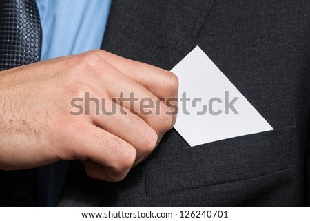 Businessman holding a business card - stock photo
