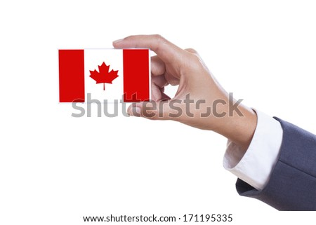 Businessman holding a business card with a Canada Flag  - stock photo