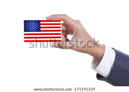 Businessman holding a business card with a USA Flag  - stock photo