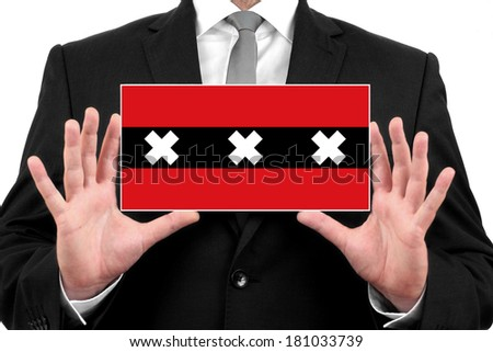 Businessman holding a business card with Amsterdam City Flag - stock photo