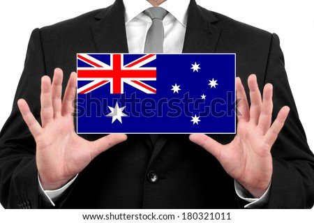 Businessman holding a business card with Australia Flag - stock photo