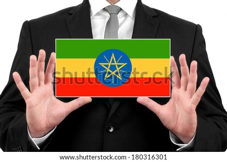 Businessman holding a business card with Ethiopia Flag - stock photo
