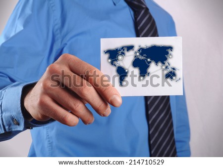 businessman holding a business card with his travel route to his cooperation partners - stock photo