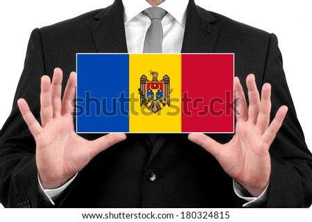 Businessman holding a business card with Moldova Flag - stock photo