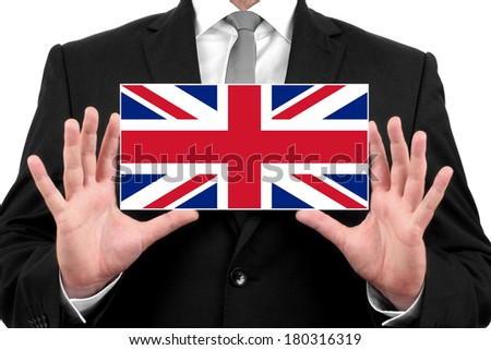 Businessman holding a business card with UK Flag - stock photo