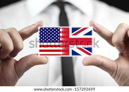 Businessman holding a business card with USA and UK Flag