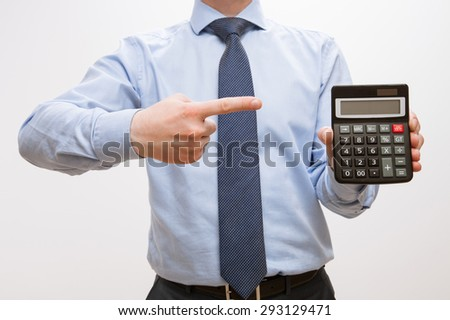 Businessman holding a calculator with empty display, white background