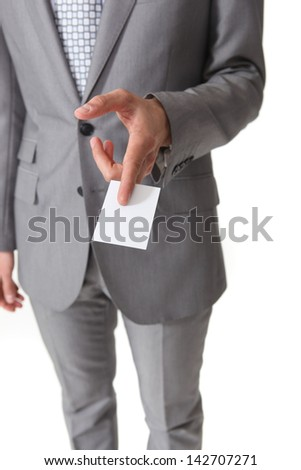 Businessman holding a card - stock photo