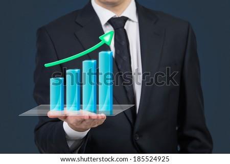 Businessman holding a chart 2 - stock photo