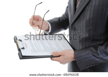 Businessman holding a clipboard. Isolated on white background - stock photo
