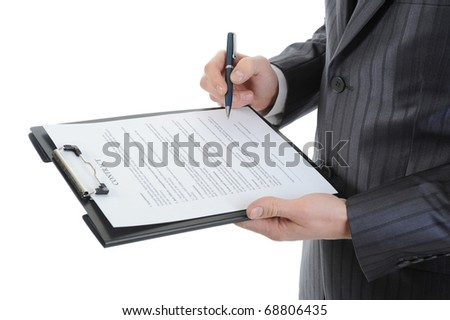 Businessman holding a clipboard signs contract. Isolated on white background - stock photo