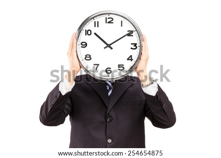 Businessman holding a clock in front of his face isolated on white background
