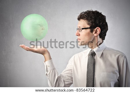 Businessman holding a crystal ball - stock photo