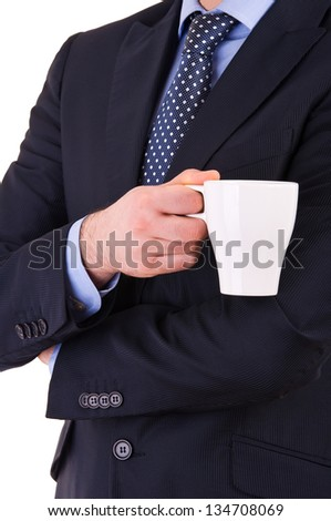 Businessman holding a cup of coffee. - stock photo