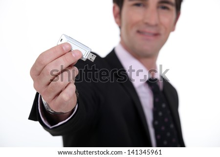 businessman holding a flash drive