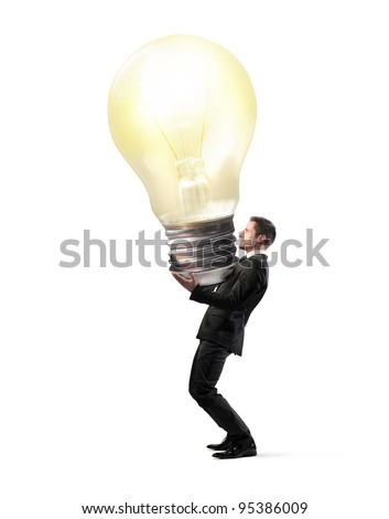Businessman holding a giant light bulb - stock photo