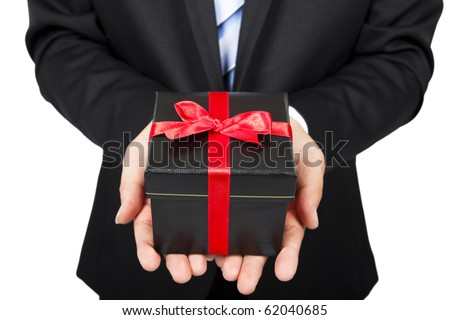 businessman holding a gift package in hand - stock photo