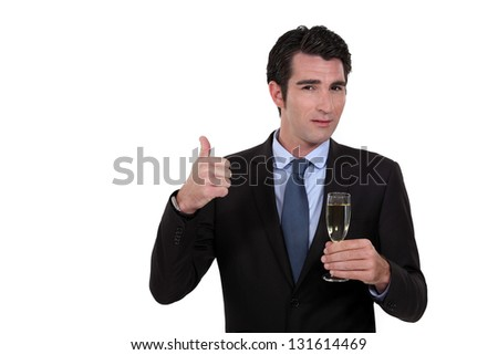 Businessman holding a glass of champagne - stock photo