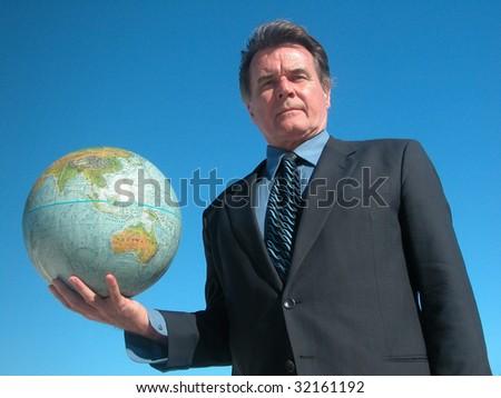 Businessman holding a globe. - stock photo
