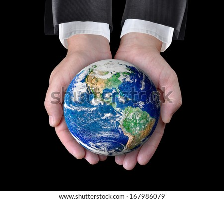 Businessman holding a globe in his hands. Elements of this image furnished by NASA  - stock photo
