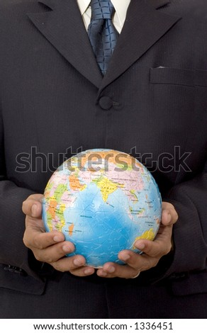 Businessman holding a Globe Puzzle with two hands