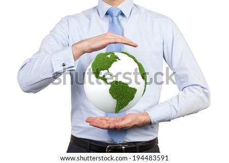 Businessman holding a green globe, USA.  - stock photo