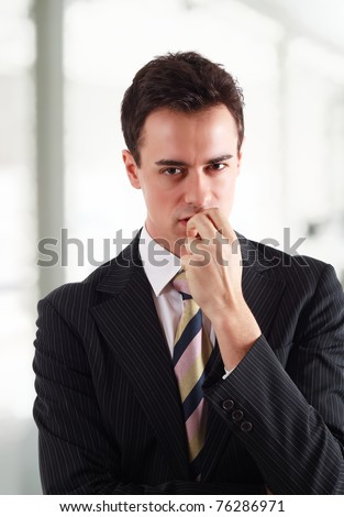 Businessman holding a grudge against someone. - stock photo
