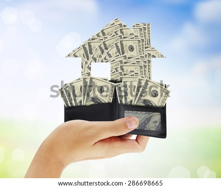 Businessman holding a house