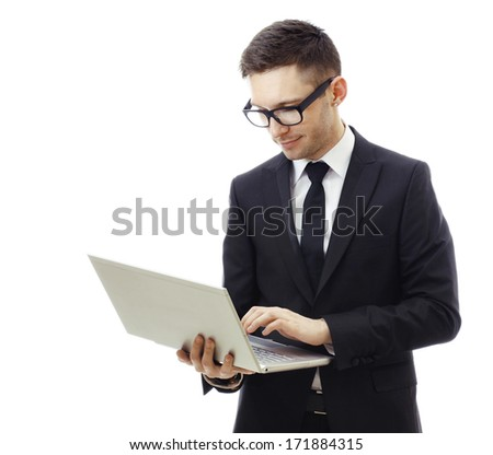 Businessman holding a laptop and smiling. Isolated against a white background.