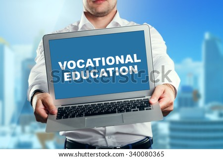 Businessman holding a laptop with an vocational education. Business, technology, internet and networking concept. - stock photo