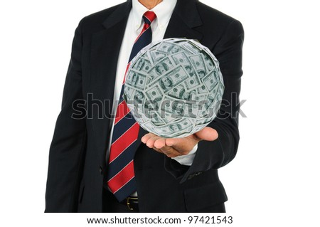 Businessman holding a large ball of money in the palm of his hand. Man is unrecognizable, wearing a suit and tie over a white background. - stock photo
