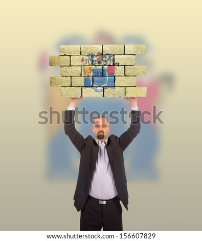 Businessman holding a large piece of a brick wall, flag of New Jersey, isolated on national flag - stock photo