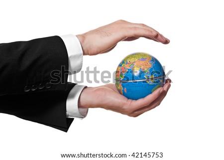 businessman holding a mini globe on white background - stock photo