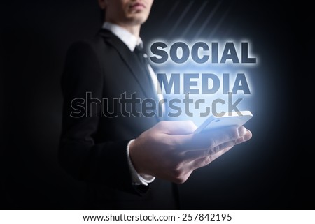 businessman holding a mobile phone with applications icons on the screen.  internet concept. business concept. - stock photo