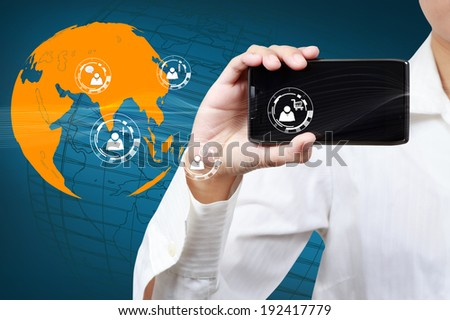Businessman holding a mobile phone with communication icon. Concept of market share on business. - stock photo