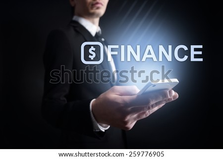 businessman holding a mobile phone with finance text  on the screen. Internet concept. business concept.