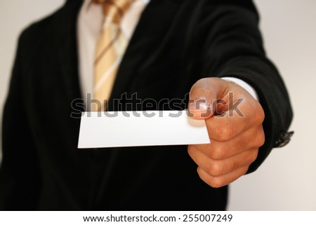 Businessman holding a name card copy space - stock photo