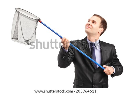 Businessman holding a net isolated on white background - stock photo