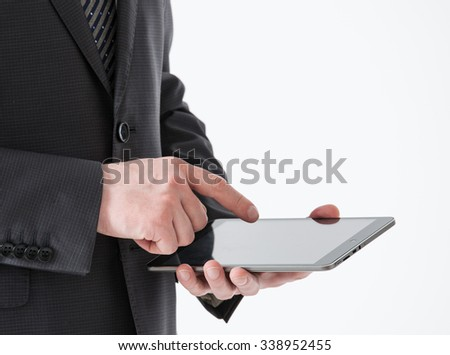 Businessman holding a pad, white background