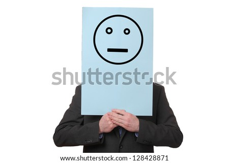 Businessman holding a paper with a neutral smiley on white background - stock photo