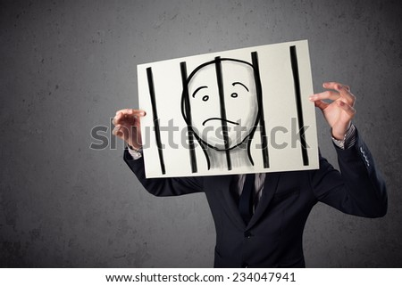 Businessman holding a paper with a prisoner in jail behind the bars on it in front of his head - stock photo