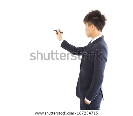 businessman holding a pencil to draw something - stock photo