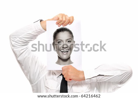Businessman holding a piece of paper over his face with a happy woman on it - stock photo