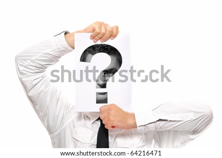 Businessman holding a piece of paper over his face with a question mark on it - stock photo