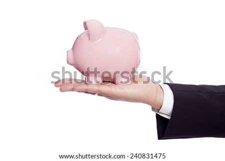 Businessman holding a piggy bank, isolated on white background