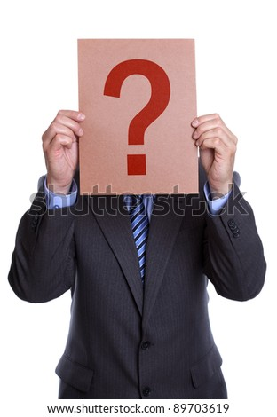Businessman holding a question mark sign in front of his face on white background - stock photo