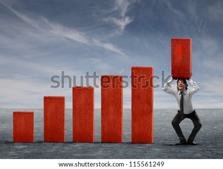 Businessman holding a red block of a business analysis - stock photo